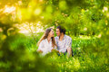 Couple in love sitting at summer park smiling adult and hugging Stock Images