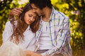 Couple in love sitting at summer park young adult and hugging Stock Photo