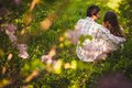 Couple in love sitting at summer park young adult and hugging back view Stock Image