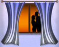 Couple in love at sunset view from the window Stock Photography