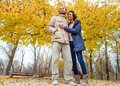 Couple in love are walking in the autumn park. Afroamerican girl with a European Royalty Free Stock Photo