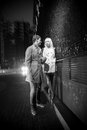 Couple in love walking on street at night black and white photo of Royalty Free Stock Image