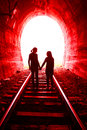 Couple in love walking together through a railway tunnel Royalty Free Stock Photo