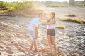 Couple in love walks on the banks of the river denim shorts and a white shirts Stock Images
