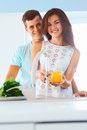 Couple in love washing vegetables in the kitchen Royalty Free Stock Photo
