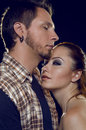 Couple of lovers cost profile the girl clings to a guy on black background Royalty Free Stock Images
