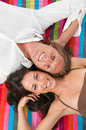 Couple lying on the beach towel Royalty Free Stock Images
