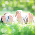 Couple lying on grass Royalty Free Stock Images
