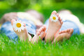 Couple lying on grass outdoors in spring park Stock Images