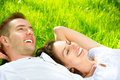 Couple lying on grass young outdoor Stock Images