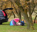 Couple lying near car at outdoor. Royalty Free Stock Images