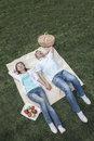 Couple lying on picnic blanket Royalty Free Stock Photography
