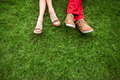 Couple lying and relaxing on the grass legs top view text space Stock Images