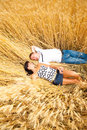 Couple lying in wheat Royalty Free Stock Photo