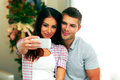 Couple making selfie photo with smarphone