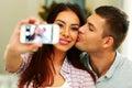 Couple making selfie photo with smarphone