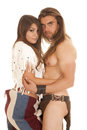 Couple man no shirt hug an american men holding on to his native american woman Stock Images