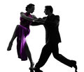 Couple man woman ballroom dancers tangoing silhouette one caucasian men women in studio isolated on white background Stock Photos