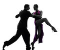 Couple man woman ballroom dancers tangoing silhouette one caucasian men women in studio isolated on white background Stock Images