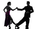 Couple man woman ballroom dancers tangoing silhouette one caucasian men women in studio on white background Royalty Free Stock Image