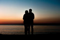 Couple man and woman hugging in love staying on beach seaside with sunrise scenery people romantic relationship friendship Royalty Free Stock Image