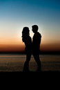 Couple man and woman hugging in love staying on beach seaside with sunset scenery people romantic relationship friendship Royalty Free Stock Images