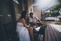 Couple: man and woman with laptop on veranda Royalty Free Stock Photo