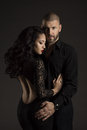Couple man and woman in love fashion beauty portrait of models embracing over black background Royalty Free Stock Photography