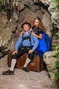 Couple man and woman in traditional bavarian dress beautiful tracht dirndl lederhosen Royalty Free Stock Photo