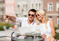 Couple with map in cafe summer holidays dating and tourism concept the city Stock Photo