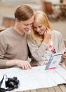 Couple with map camera and travellers guide summer holidays dating city break tourism concept Stock Photography