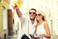 Couple with map camera and travellers guide summer holidays dating city break tourism concept Stock Photo