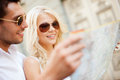 Couple with map in the city summer holidays dating and tourism concept Stock Photos