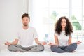Couple meditating in the morning Royalty Free Stock Photo