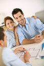 Couple meeting architect to see plan of house young construction planner Royalty Free Stock Photography