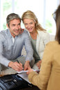 Couple meeting financial advisor at home Stock Photos