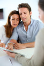 Couple meeting real estate agent young financial adviser Royalty Free Stock Photos
