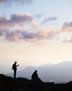 A couple meeting the sunset on top of mountain Royalty Free Stock Photography