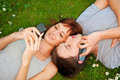 Couple with mobile phones outdoor Royalty Free Stock Photo