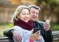 Couple with mobile phones Royalty Free Stock Photo