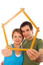 Couple with model house Stock Photos