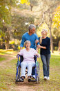 Couple mother walk loving middle aged taking disabled for a outdoors Stock Photography