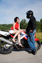 Couple with motorbike Stock Image