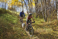 Couple mountain biking Stock Photo