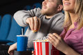 Couple at the movie theatre Royalty Free Stock Photo