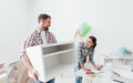 Couple moving furnishings in their new house Royalty Free Stock Photo