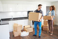 Couple Moving Into New Home And Unpacking Boxes Royalty Free Stock Photo
