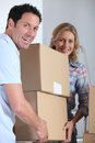 Couple moving pile of boxes Royalty Free Stock Image