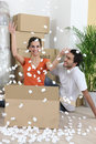 Couple moving into their new home Stock Photos