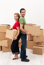 Couple moving in to a new home Stock Photo